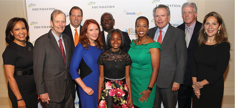 The SIFMA Foundation honored champions of Financial literacy - Tom James of Raymond James and Charlotte McLaughlin of PNC Capital Markets - at the 2019 Tribute Dinner in New York City.